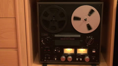 Classic reel to reel tape recorder, analog display, magnetic tapes spinning - stock footage