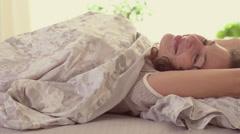 Sleeping girl wakes up Stock Footage