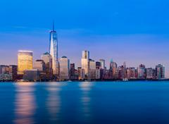 skyline of lower manhattan at night - stock photo