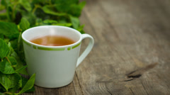 Steaming fresh mint tea - stock footage
