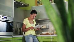 Woman reading the letter with bad news - stock footage