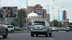Traffic drives past popular shopping mall in Astana Stock Footage