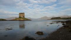 Castle Stalker reflected in Loch Laich Scotland Stock Footage
