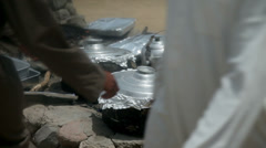 Prepeared food sealed in black dishes covered with aluminium foil Stock Footage