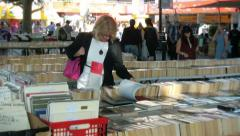 Woman at a book stall Stock Footage