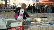 Stock Video Footage of Woman at a book stall