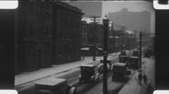 Winter driving in the city. (Vintage 1920's 16mm film footage). Stock Footage