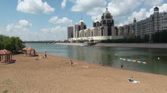 Astana, Kazakhstan, artificial beach in city centre, downtown resort, skyline Stock Footage