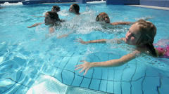 Close up of kids swimming in pool - stock footage