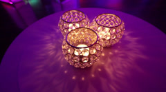 Three crystal candle holders on a table Stock Footage