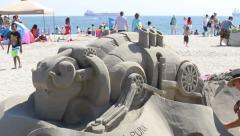 Artist Works on Steam Punk Sand Sculpture Pan Left - stock footage