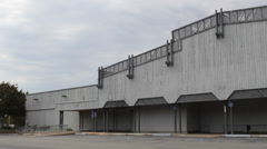 Abandoned Building and Parking Lot Pan Right Stock Footage