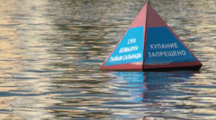 Russian language on buoy in Astana river Stock Footage