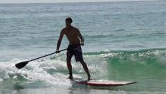 Paddle board surfing Stock Footage