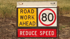 Road work ahead - reduce speed sign Stock Footage