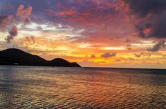 Vibrant tropical sunset Stock Photos