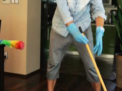 Man sweeping the floor at home Stock Footage
