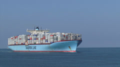Ultra large container vessel Elly Maersk  + zoom out basalt blocks sea dike Stock Footage