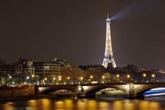 Eiffel tower with night illumination and pont des invalides Stock Photos