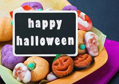 sweets and candies for halloween and blackboard - stock illustration
