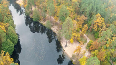 River and wood in autumn. Charm of the nature. Aerial clip - stock footage