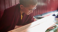 Stock Video Footage of A young monk reading the buddhist script during a ritual.