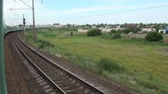 Train rides through Kazakhstan village Stock Footage