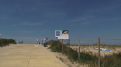 Dune crest with dog walker + Billboard Pilot Project building with nature Stock Footage
