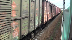 Riding past train carriages in Kazakhstan Stock Footage