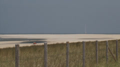 Sandbank with monitoring mast in North Sea + zoom out Sand Engine project Stock Footage