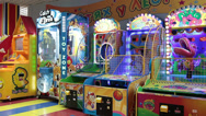 Stock Video Footage of Colorful coin-operated machines are in children gaming zone