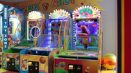 Stock Video Footage of Illuminated coin-operated machines are in children gaming zone