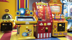 Colorful coin-operated machines are in gaming zone Stock Footage