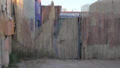 Bamboo Urban Fence Pan Left Stock Footage