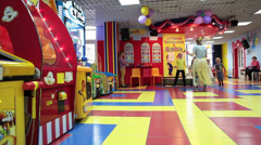 Children playing with funnyman at the birthday party in entertainment zone - stock footage