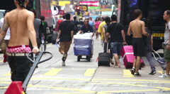 Mongkok Hong Kong Delivery workers and crowds street view Stock Footage