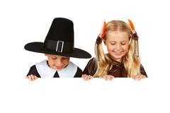 thanksgiving: pilgrim and indian look down - stock photo
