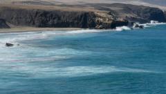 Big waves surfers beach la pared 11090 Stock Footage