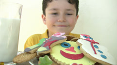 Child eating yummy cookies - stock footage