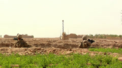 United States Marines take cover in a fox hole in the War in Afghanistan Stock Footage