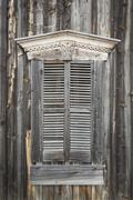 Wooden shutters on window of old building Stock Photos