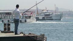 Fishing man in Istanbul Turkey. Fastforward. (Editorial) Stock Footage