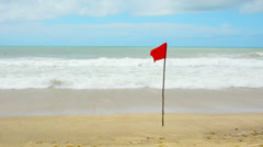 Storms season. red warning flag on the beach - no swimming Stock Footage