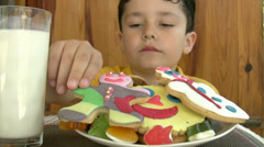 Stock Video Footage of Child eating yummy cookies