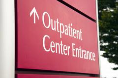 big red hospital outpatient center emergency entrance health care - stock photo