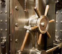 Front of bank vault massive door handle combination lock dial Stock Photos