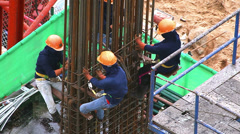 Construction workers and Concrete reinforcement Stock Footage