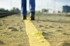 Stock Photo of walking on asphalt road.