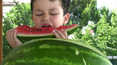 Little boy eating watermelon Stock Footage
