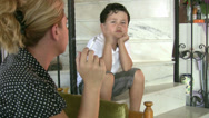 Stock Video Footage of Little boy looking at his mother while smoking cigarette